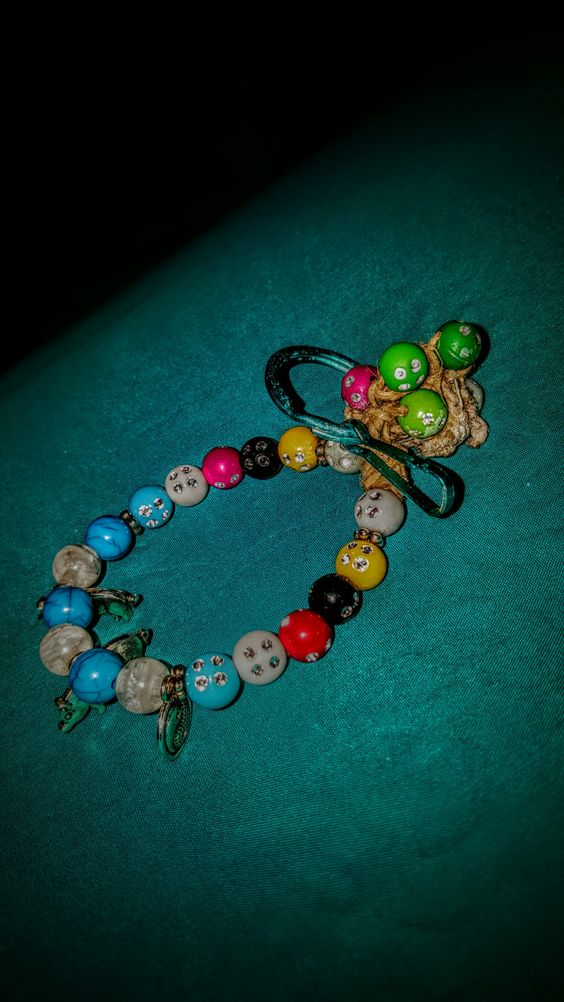 Beaded with charms and key chain latch! 6.00 Each