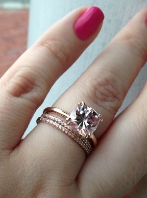 8.5mm barely pink cushion moissanite (harder than morganite( with 1.5mm light pink diamonds bands in 14K rose gold from Schubach's. engagement ring I love how different this one is from the stereotypical rings that a ton of people has