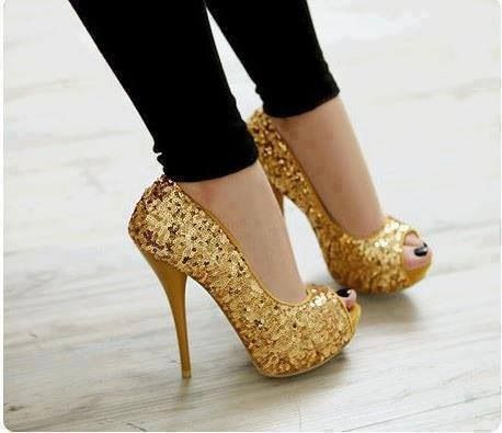 Glittery gold stiletto high heeled pumps with rounded vamp peep