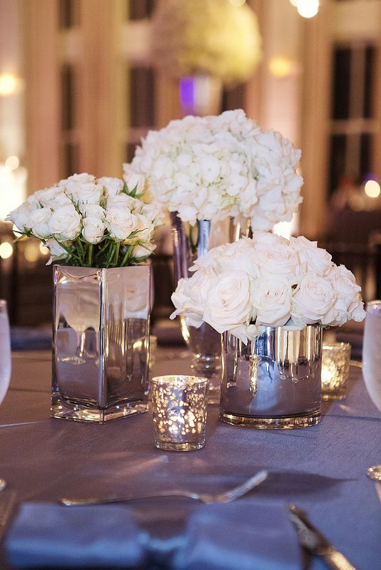 Don't know how big you are on white flowers, but I love the idea of silver mirrored vases for centerpieces.