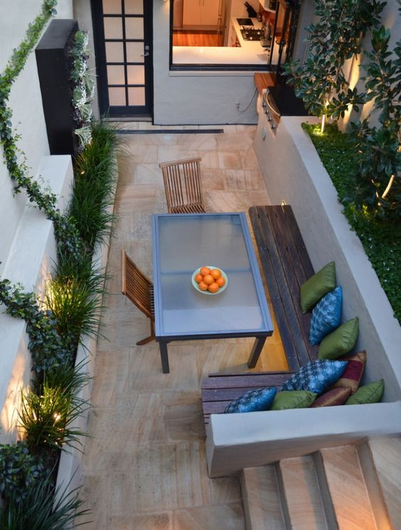 bench seating to make best use of a small space, like the idea of the bench to use over the planter, use back wall to put cushions up against it