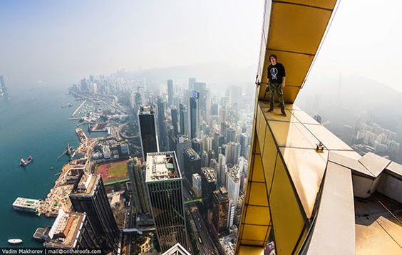 Images That Will Make Your Heart Stop Russian Traveler Climbs - Daredevil duo climb hong kongs buildings capture like youve never seen