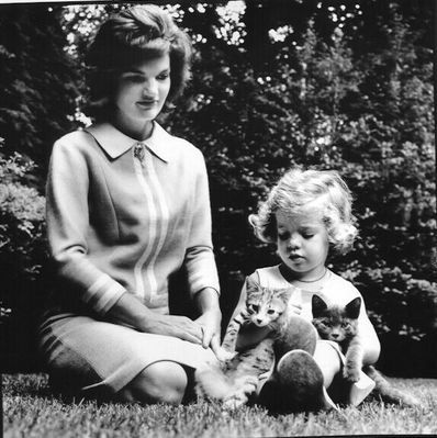 jackie and caroline kennedy with two cute kittens.