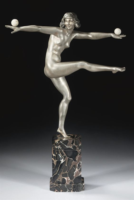 MARCEL BOURAINE | BALANCE A SILVERED AND COLD-PAINTED BRONZE FIGURE, CIRCA 1925
