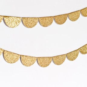 This glittery garland is the perfect festive addition to your special event or holiday decorations! It is made from glittered card stock paper which has been cu