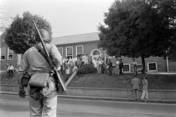 1957: Students at the North Little Rock High School blocked the doors to prevent six African American students from entering. Getty Images