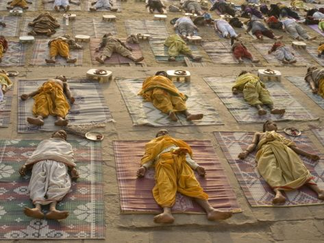 My favorite posture! Students of a Sanskrit School Performing the Savasana Posture During Daily Yoga Lesson, India
