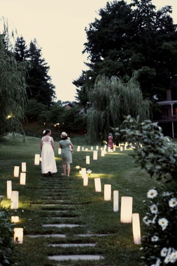 Tall lanterns leading the way to the wedding. Love this idea to line the aisle as well! Photo: http://www.belathee.com