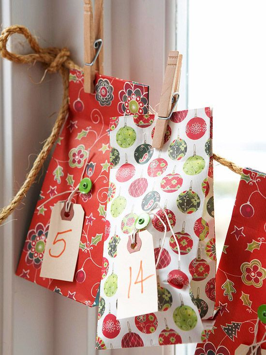 Number plain tags and tie to predecorated gift bags. For fun, don't hang the bags in order -- make it a challenge to find the day's surprise: http://www.bhg.com/christmas/crafts/advent-calendars/?socsrc=bhgpin112214adventcalendarlineup&page=6