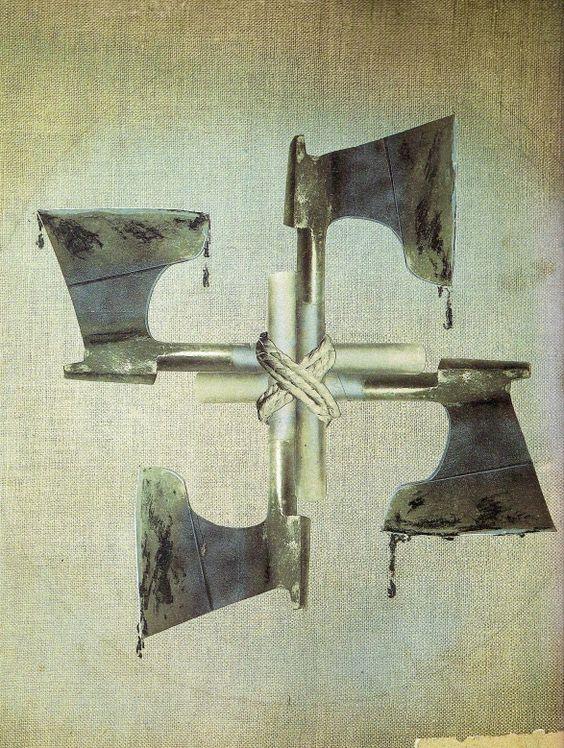 John Heartfield, aus dem Exil in Prag bei der AIZ ( Arbeiter Illustrierte Zeitung ) am 09.03.1934, Der alte Wahlspruch im Neuen Reich, Blut und Eisen.