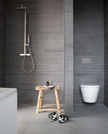 Grey on Grey. Mixing up the tile size and the tile orientation and having a slightly lighter floor tile looks really effective.