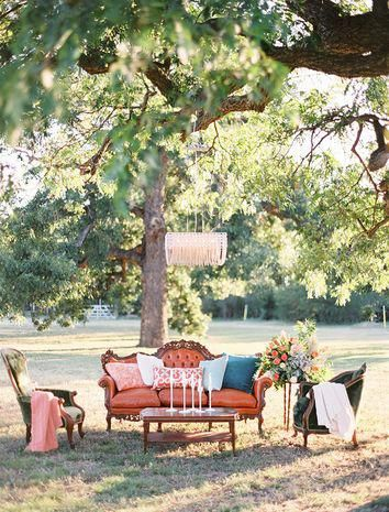 Unique vintage outdoor wedding reception lounge idea - antique furniture with coffee table in center with candlesticks + chandelier hanging from tree Ben Q. Photography