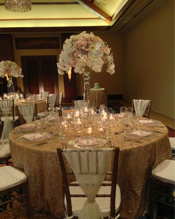 an elegant wedding reception in champagne gold blush