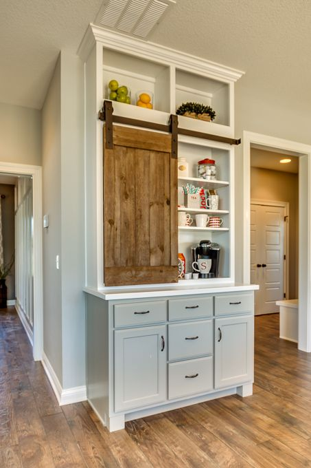 Coffee station love the barn style door used as a cabinet for Kitchen coffee bar cabinets