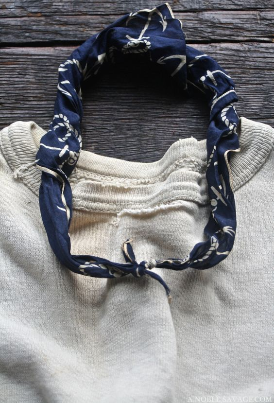 Bone white sweatshirt | Twisted navy blue pattern neckerchief scarf | Worn jersey | Frayed edges