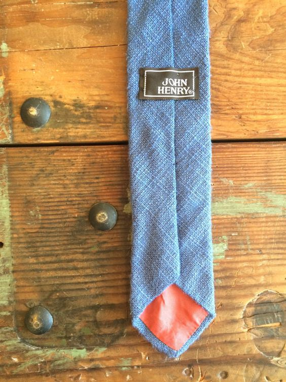 This vintage John Henry tie is made of luscious beige raw silk. Material: 100% Raw Silk Measurements: Length: 55 Width (at Widest Point): 2.5