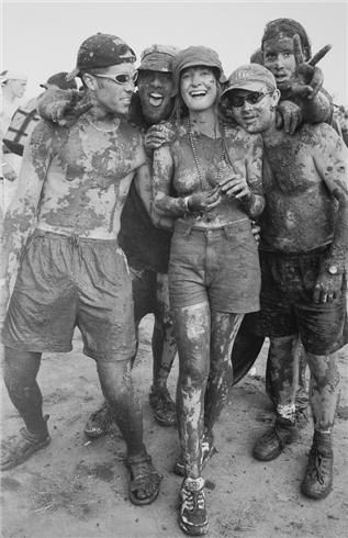 The most famous rock event of the last millenium was also the wettest, muddiest and maddest! Photo by Henry Diltz | Fans, Woodstock 1999