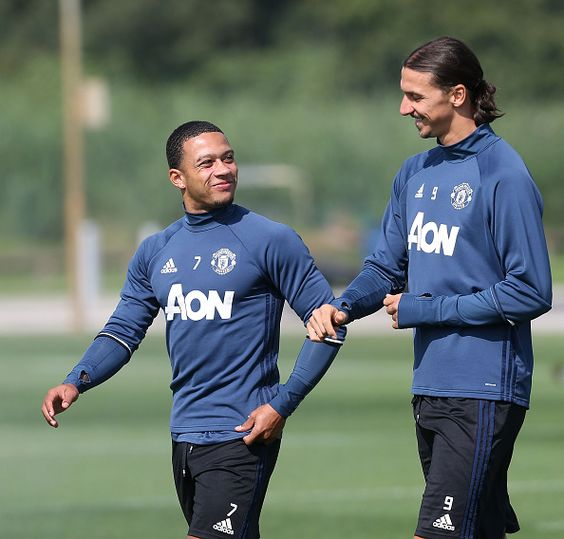 Memphis Depay chats with Zlatan Ibrahimovic of Manchester United during a first…