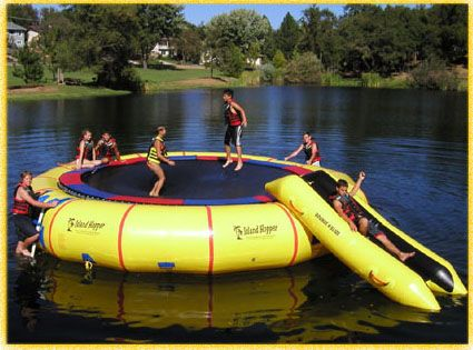Water trampoline and slide!...OMGosh, I would love this!!!