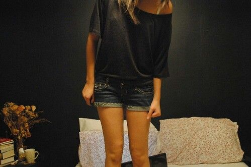 Black off the shoulder top with jean shorts