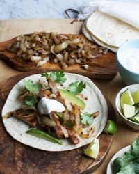 Grilled Pork and Onion Tacos   Contributed By: Melissa Rubel Jacobson   Grilling pork quickly not only keeps it moist, but adds a charred, smoky flavor that is lovely in these tacos. Remember to grill the cutlets only until they're just cooked through; leave them on the heat any longer and they can dry out.    From: foodandwine.com