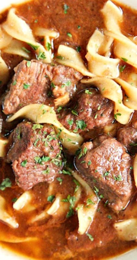 {Slow Cooker} Steak Soup ~ sirloin roast, beef broth, onion soup mix, tomato paste, Worcestershire sauce and egg noodles. Cooks all day in the crockpot - even the noodles