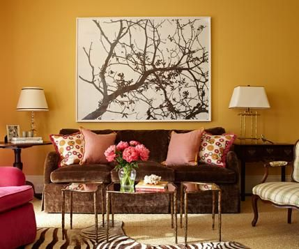 Youthful Yellow And Brown Living Room A Bright Yellow Orange Wall Sets The Stage For Eye