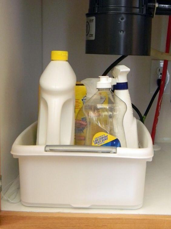 Under Kitchen Sink Organization.  Cheap plastic tubs for under sink organization.