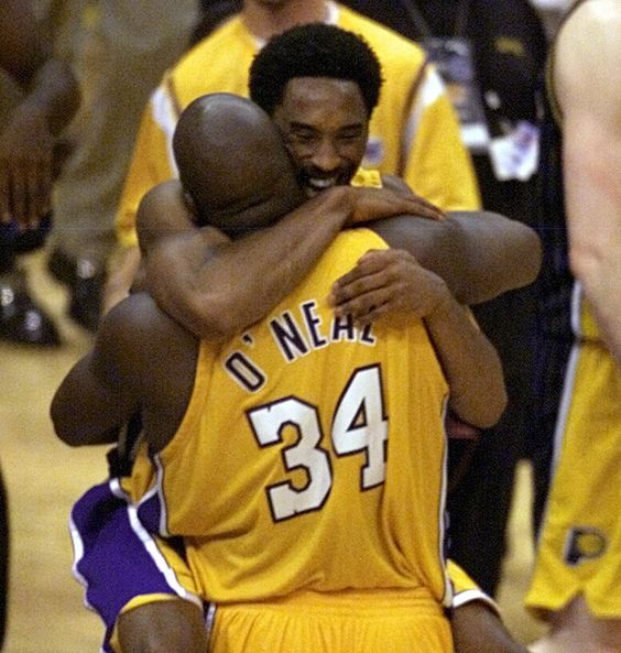 Shaq and Kobe hug after winning Game 6 of the NBA Finals vs. the Pacers in 2000. (Photo: USA TODAY Sports)