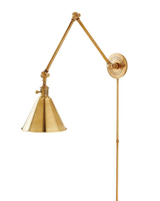 <p>Angular lines and antique brass take us back to the days (and nights) spent in cozy university libraries. The minimalist lines and bright white interior feel clean and fresh. With an ample range of motion (the arms pivot and extend), it's our go-to task lamp.</p>