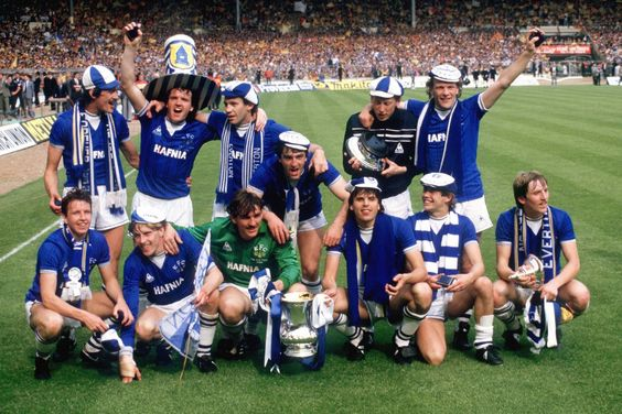 Everton celebrate with the FA Cup: (back row, l-r) Derek Mountfield, John Bailey, Peter Reid, Alan Harper, Andy Gray; (front row, l-r) Trevor Steven, Kevin Richardson, Neville Southall, Kevin Ratcliffe, Graeme Sharp, Adrian Heath, Gary Stevens