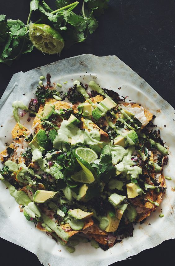 this bad-ass platter of mean green nachos has avocado, kale, vegan cheese, and a tangy cilantro sour cream.