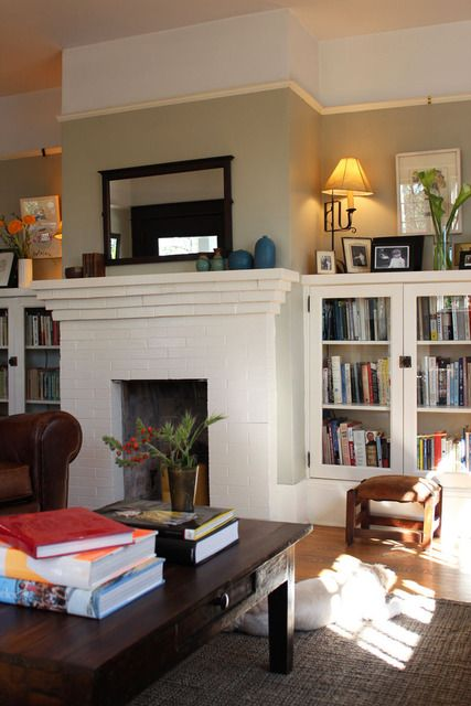 Model Living Room Bookcases Flanking Fireplace And Vaulted Ceiling Living