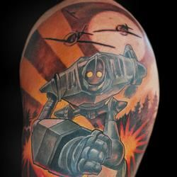 Iron Giant... great movie but I like this tattoo for the bold lines coming from the explosion