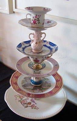 Tiered Stand from plates & cups!  Too bad I didn't see this before my Alice in Wonderland B-Day Party!: