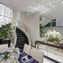 Casa Tripoli: Salas de jantar translation missing: br.style.salas-de-jantar.moderno por Arquiteto Aquiles Nícolas Kílaris