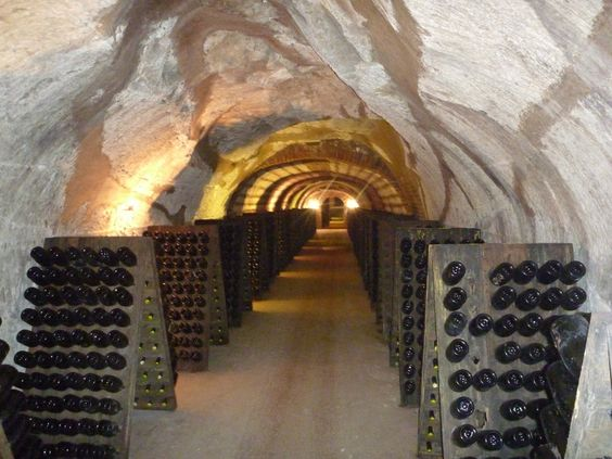 Champagne in lines of pupitres in the cellars of De Venoge.