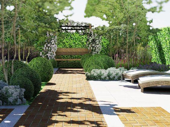 Moderne cottage stijl. Met een romantische bank omringt met clematis bloemen en buxus wolken.