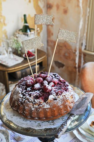 Glitter flags atop a berry cake.  How delightful!  Photo Copyright Heather Bullard