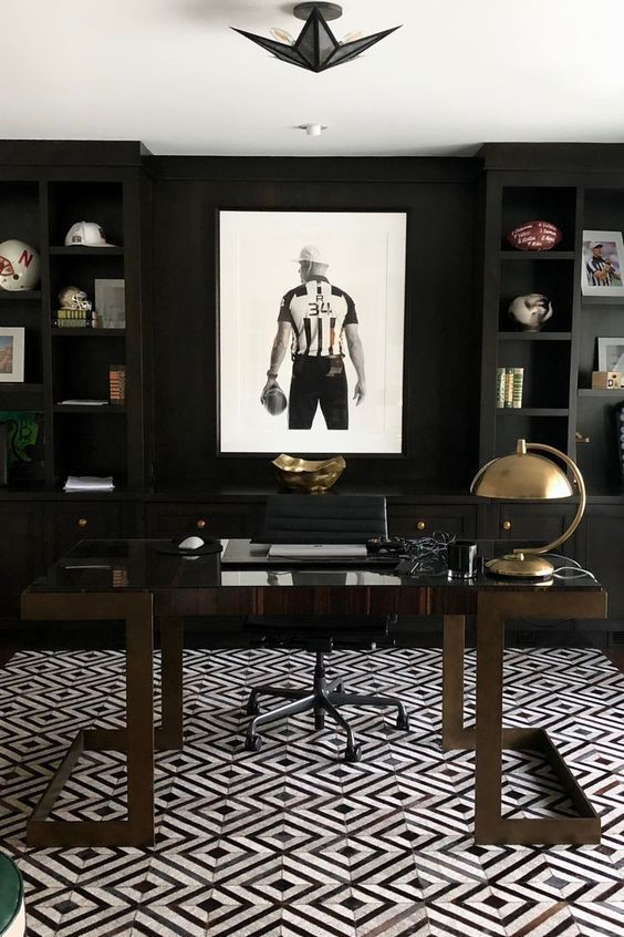 A Modenr Moody Masculine Home Office With Blakc Built In Shelves
