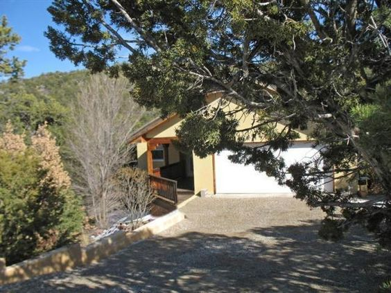 Property 39 Avenida Del Sol, Cedar Crest, NM 87008 - MLS® #841296 - Clear mountain air and stunning views await you! This delightful East-Mountain retreat is nestled among the trees in the beautif