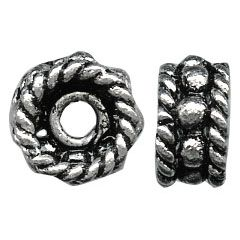 A sterling silver rope-edged wheel bead