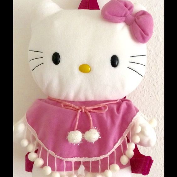 HELLO KITTY Plush Poncho Pink White Small Backpack New without tag.                          Measurements:                                           Length: 13 inches Width: 11 inches Depth: 4 inches Hello Kitty Bags Backpacks