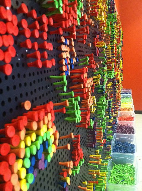 Colored golf tees in peg board- kind like a light bright without the light.: