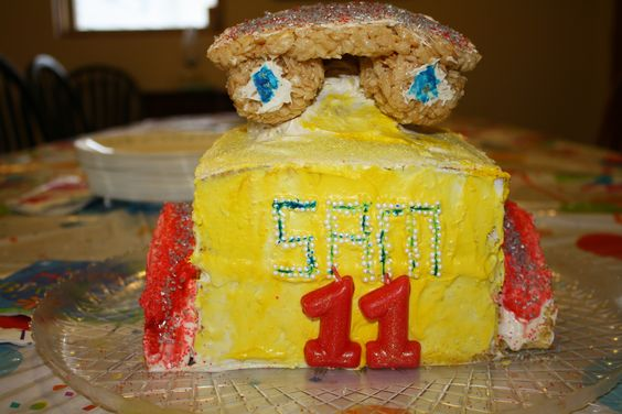"""Robot cake for my son who loves to buil robots but didn't want a """"baby cake"""" of course for his 11th birthday. This is supposed to be a cross between Johnny Five from Short Circuit, Wall-E, and a drawing my son made of a robot he was designing."""