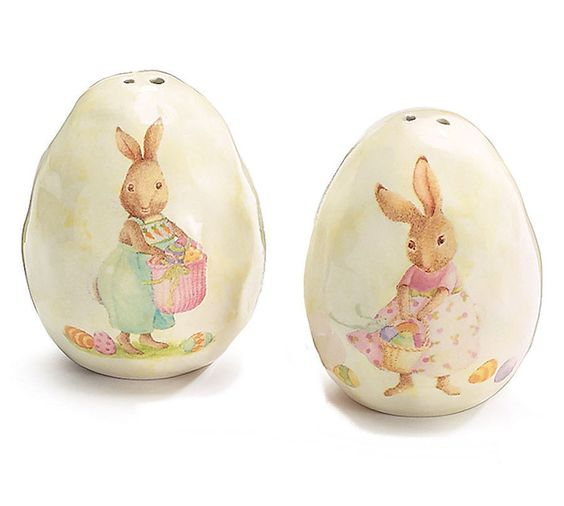 Darling Bunnies on Eggs Salt & Pepper shakes from the CARROTON GLEN Collection by burton+BURTON. Shaped as eggs, one shaker has a boy bunny, the other a girl. This ceramic pair of shakers has a slightly dimpled texture. FDA Approved for use.Each measures 2.5 inches tall x 2 inches wide and deep. Each has a rubber plug on the bottom for filling. Packaged in a gift box suitable for wrapping! #BurtonandBurton