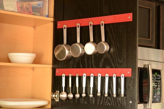 Measuring Cup and Spoon in cupboard using 5 gallon paint sticks
