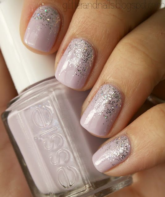 I love this, the subtlety of the glitter over the nail polish. Do you think her nails are fake?