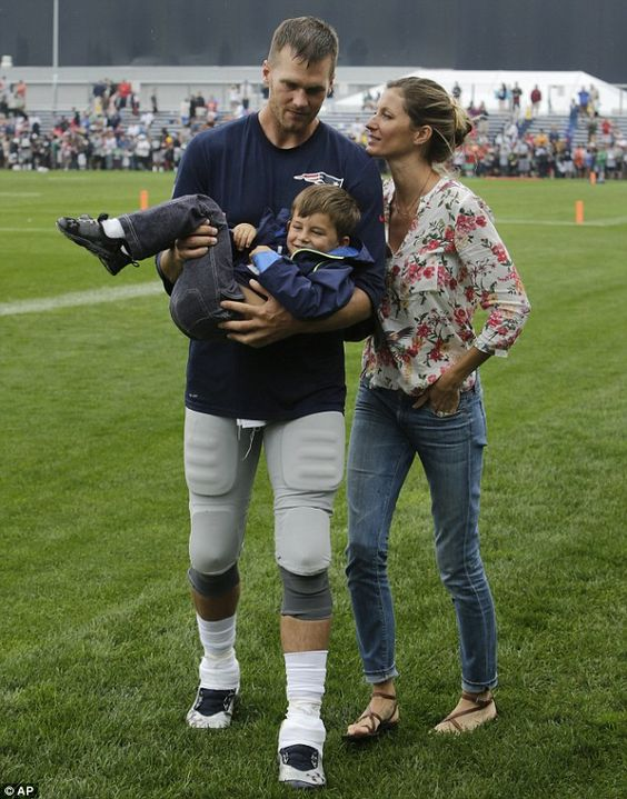 Could they be any cuter! Gisele Bundchen and son Benjamin cheered on husband Tom Brady during a New England Patriots training session in Foxborough, Massachusetts on Tuesday