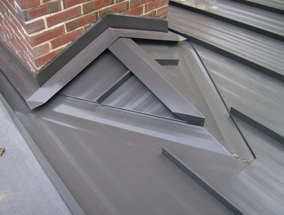 Standing Seam Painted Steel Roof View Of Chimnet Saddle